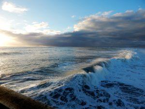 Wave crashing off Oceanside Pier