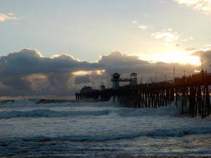 Huge winter clouds behind Oceanside Pier sunset