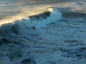 Surfer big wave Oceanside Pier