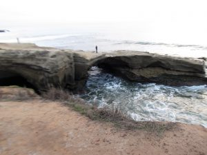 sunset cliffs natural park stone bridge over water