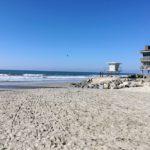 Buccaneer Beach sandy shore lifeguard station rocks