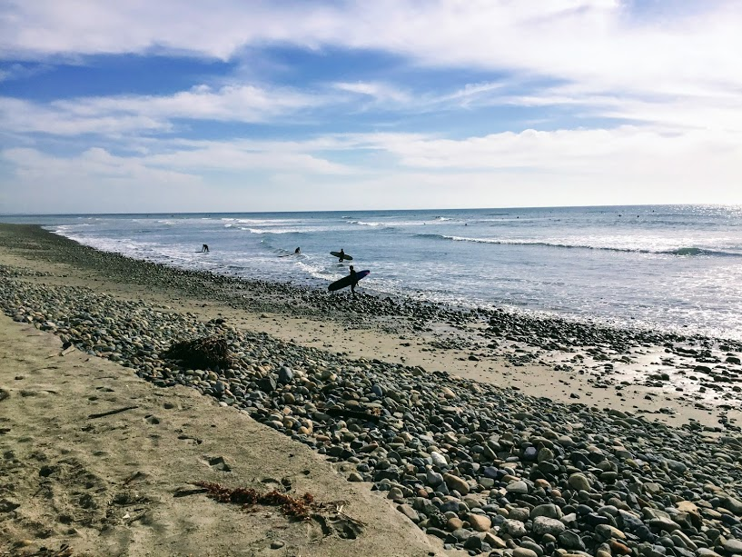 San Onofre Surfing Beach rocky beach surfer walking to water
