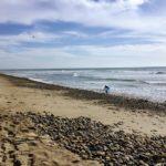 The Point Beach sand surfer rocks water