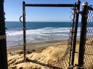North Ponto Beach view chain linked fence