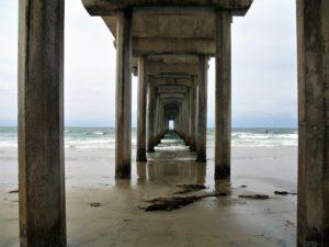 SIO Pier underneath pilings wet sandy shore