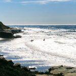 bodyboarding la jolla strand beach waves rocks blue sky