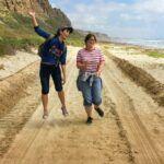 girls bluff beach jumping jogging