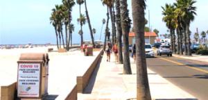 entrance Oceanside Harbor trees street car beach