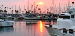 sunset harbor oceanside pink sky fishing vessels