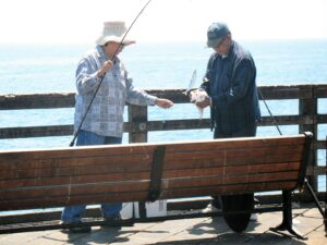 fishing oceanside pier scaled fishing pole two people